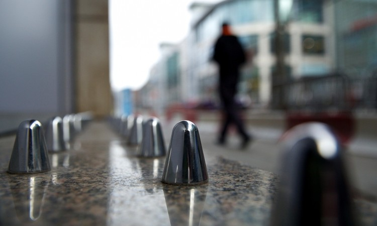 "Defensive Architecture Creates Unlivable Cities, ""Anti-homeless"" spikes installed in Manchester. Image © Christopher Thomond via the Guardian"