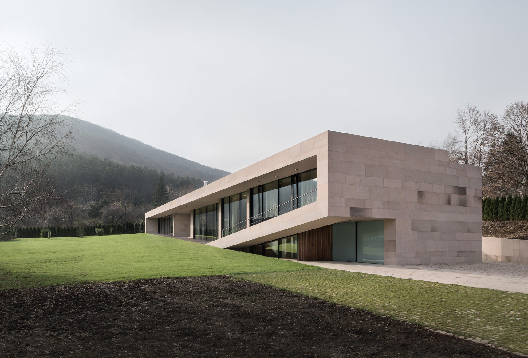 Gallery of slight slope long house i o architects 10 for Modern long house plans