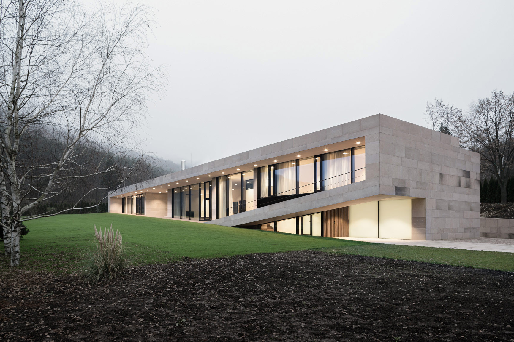 Ground Floor Modern Elevation : Slight slope long house i o architects archdaily