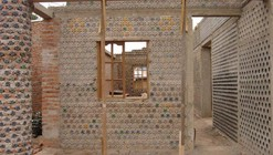 This Plastic Bottle House Turns Trash into Affordable Housing in Nigeria