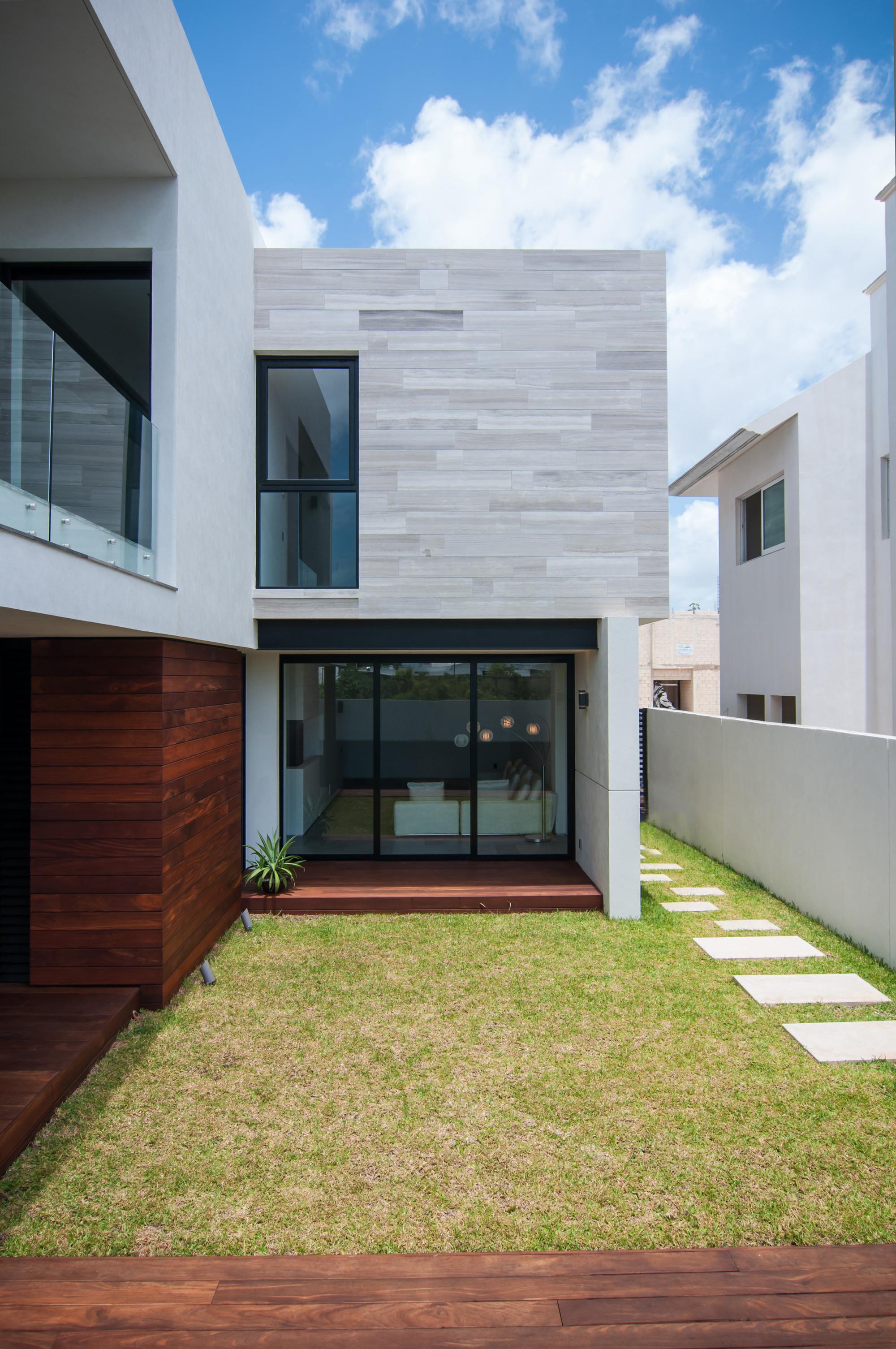 Galer a de casa paracaima taff arquitectos 11 for Casas minimalistas 180m2