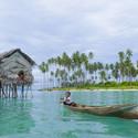 Badjao child rowing near coast. Image © idome via Shutterstock