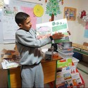 A child poses with his plan for a safe playground. Image © CatalyticAction