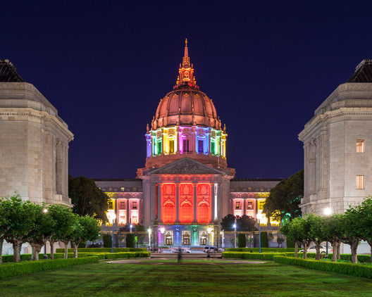 San Francisco City Hall illuminated in rainbow colors in honor of Pride Week Image © Nickolay Stanev via Shutterstock.com