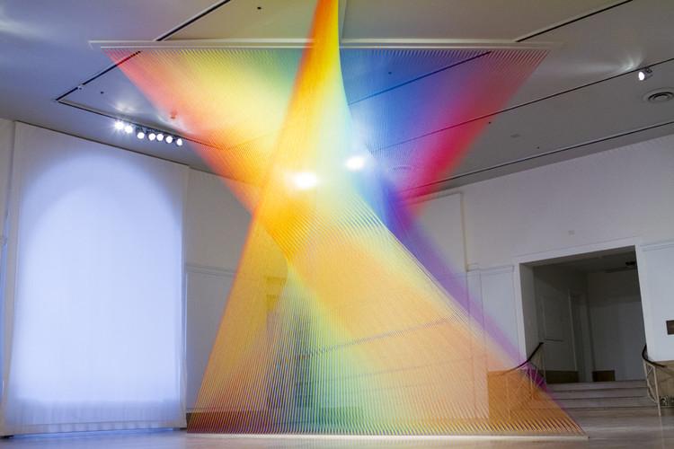 Exhibition: The Shape of Light: Gabriel Dawe, Gabriel Dawe, Plexus no. 30, 2015. Site-specific installation at the Newark Museum.  Gütermann thread, hooks and wood,  199 x 238 x 183 in. ©Gabriel Dawe.  Photo © Pierce Jackson