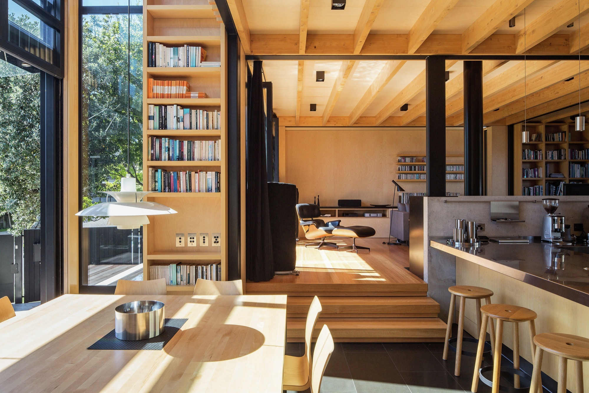 Sunken dining space and a timber living space of a boatshed in Auckland, New Zealand [OS] [2000×1333]
