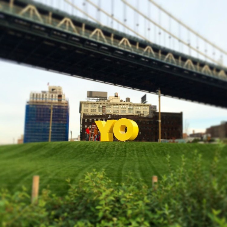 "Good Public Art in Bad Public Spaces: Art Critic Jerry Saltz Takes on the Built Environment, Deborah Kass' sculpture ""OY/YO"" under the Manhattan Bridge. Image © Flickr user DUMBOBID, licensed under CC BY-NC-ND 2.0"