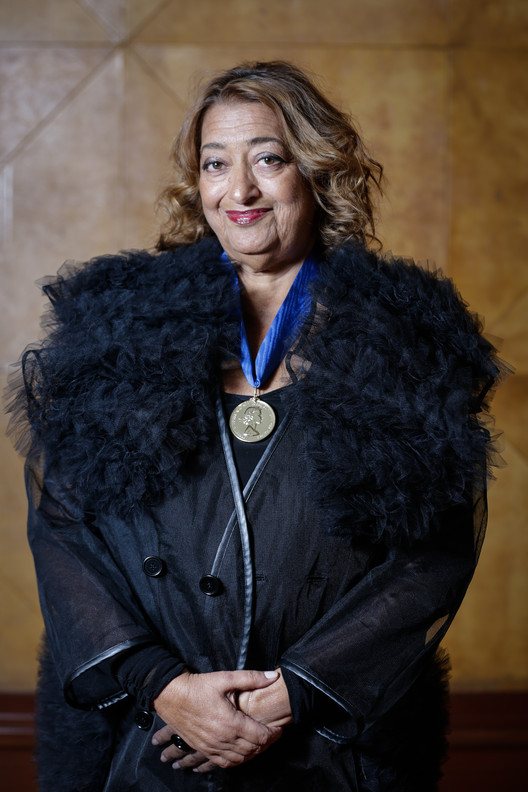 Dame Zaha Hadid wearing the 2016 RIBA Royal Gold Medal. Image © Sophie Mutevelian