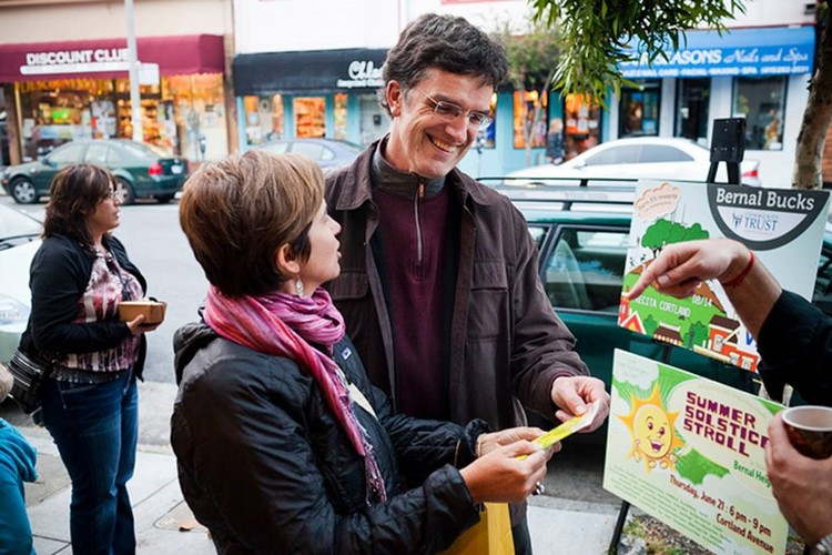 Talk & Book Signing: Smart Economic Development through Enterprise Pollinators, Arno Hesse co-founded of Bernal Bucks, a local debit card issued by a credit union in San Francisco. Image © Bay Citizen