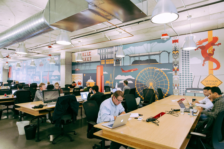 This Kickstarter Campaign Hopes to Fund a Coworking Space Specifically for Architects, WeWork's South Lake Union office in Seattle. Spaces such as these have proved very popular for small businesses, but they don't exactly work for architects.. Image Courtesy of WeWork