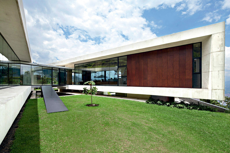 Casa de aire vidrio l pez montoya arquitectos - Casas prefabricadas en las palmas ...