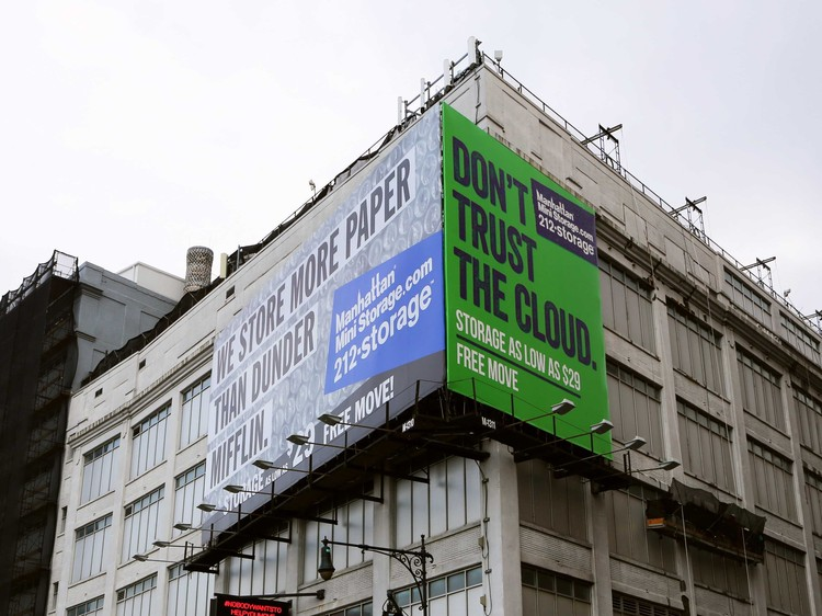 "Cloud Urbanism: Towards a Redistribution of Spatial Value, A billboard advertisement for Manhattan Mini-Storage. The green background and mention of ""the cloud"" is a direct reference to MakeSpace. Image via Business Insider, MakeSpace"