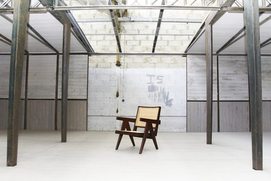 One of Jean Prouvé's Demountable Houses on display with an Easy Armchair by Pierre Jeanneret. Image Courtesy of Forward