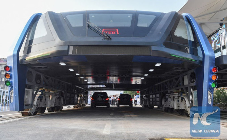 China's Futuristic Straddling Bus Becomes a Reality, Begins Testing Period, via Xinhua News Agency