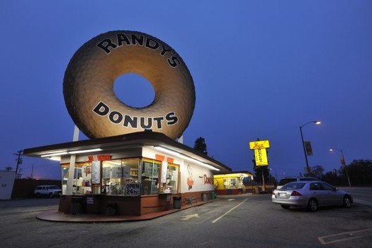 "Sin City Embellishment: Expressive or Kitsch?, Randy's Donuts shop and sign (a ""decorated shed"") by Extra Medium (CC BY 2.0). Image via 99 Percent Invisible"