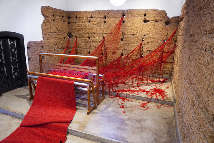 "Tatiana Blass' ""Penelope"" Crosses Chapel Walls with Enigmatic Red Wool, © Everton Ballardin. Via Colossal"
