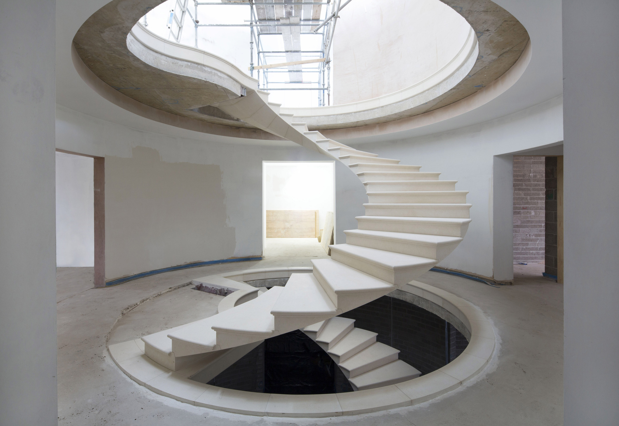 See The Engineering Behind This Floating, Award Winning Stone Helical Stair  | ArchDaily