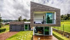 Casa Vistas ao Vulcão / ARQ. Arte y Diseño Digital
