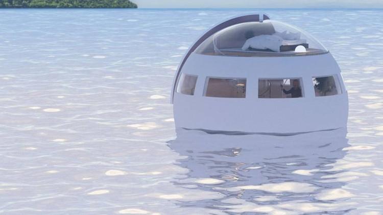 Cápsulas flutuantes oferecem transporte e pernoite em parque temático japonês, The capsules will slowly float 3.75 miles to the island overnight