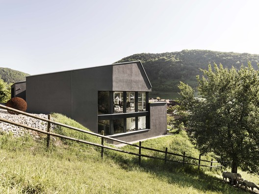 Single Family House on a Slope / Dost