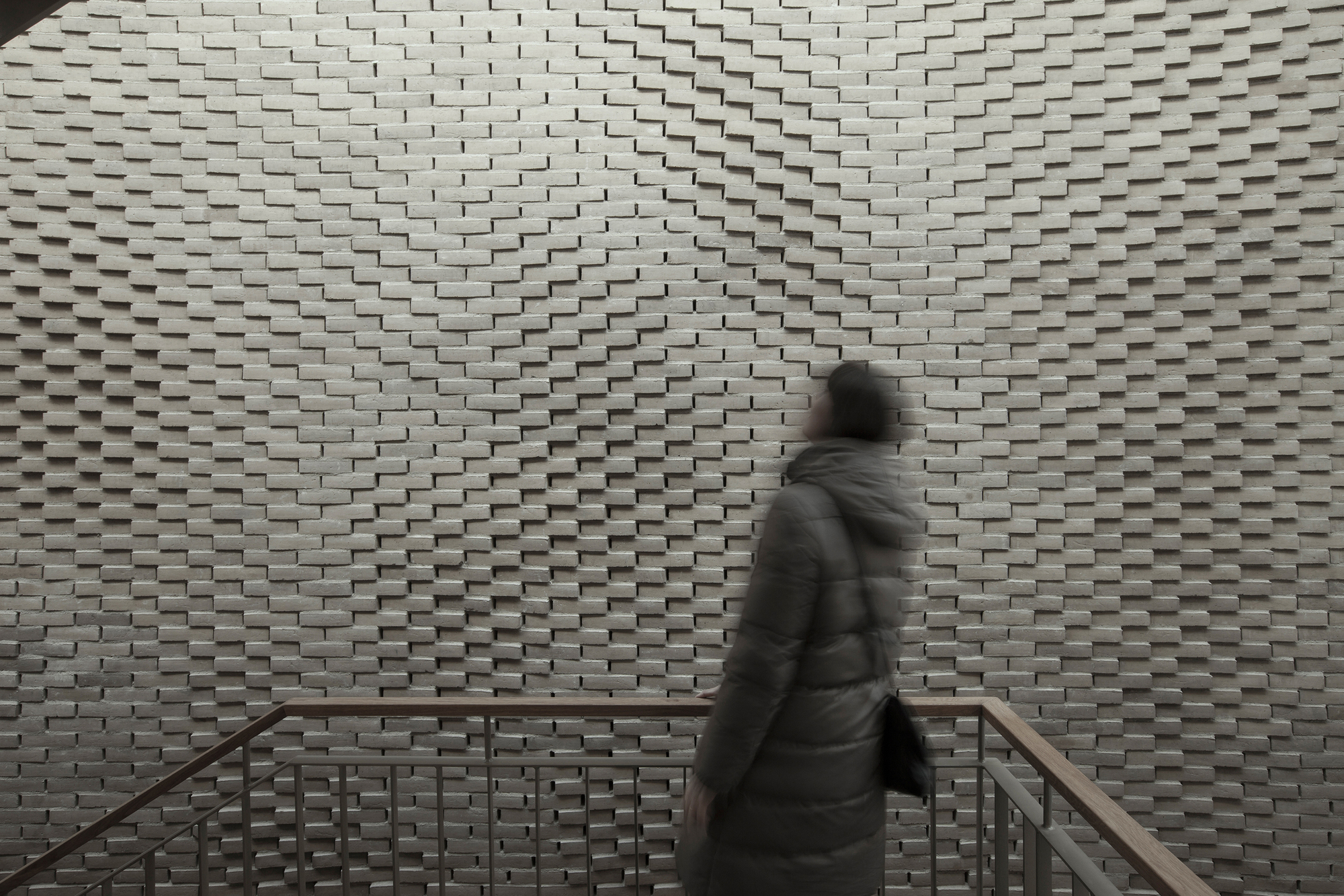 this handlaid brick feature wall was inspired by soundwaves in water