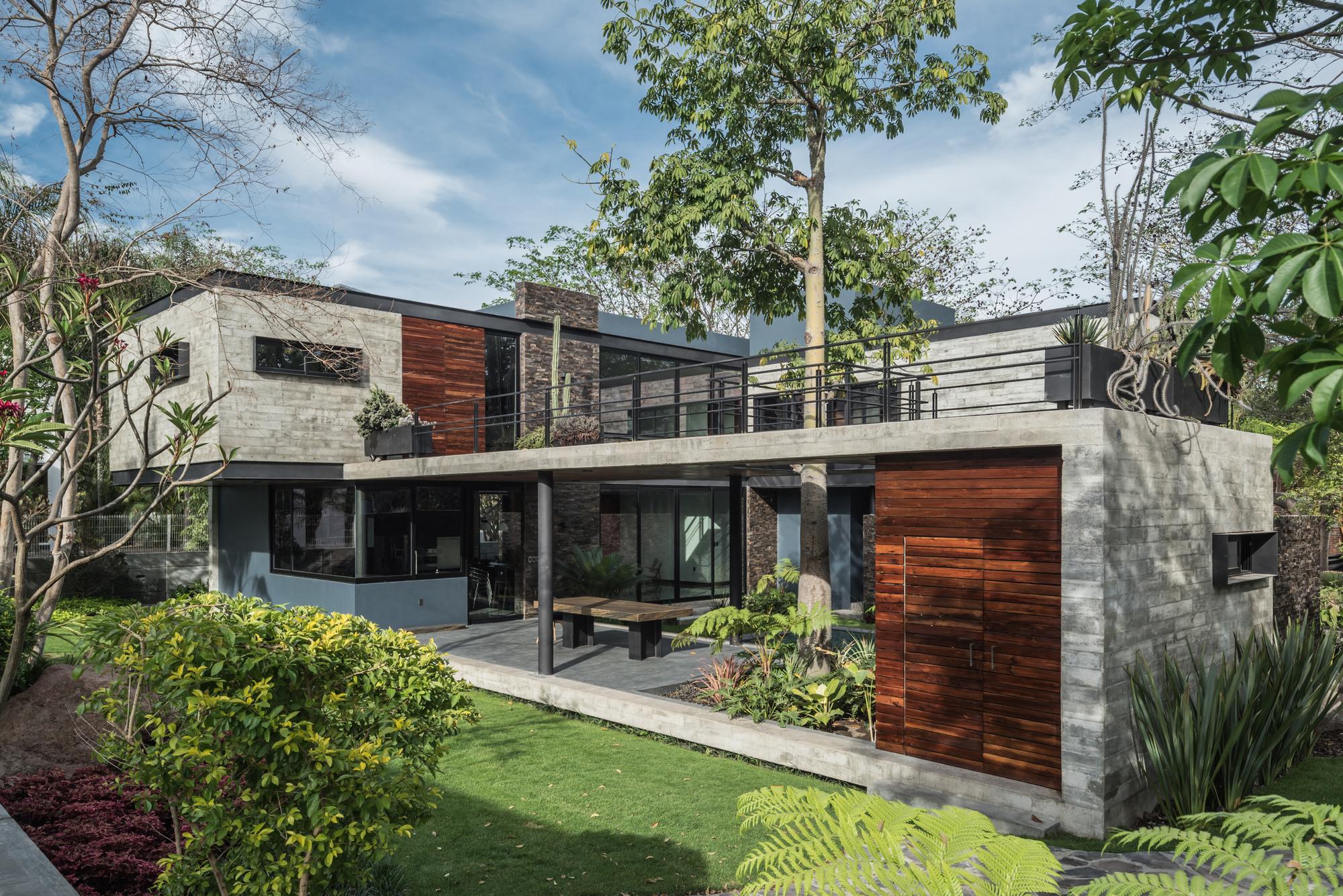 Galer a de casa kalyvas di frenna arquitectos 19 for Casa di tronchi moderna