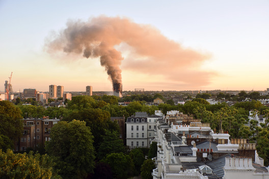 Grenfell Tower, North Kensington, pluming smoke. Photograph taken at 06.15 BST on the 14th June 2017. Image © Selim Halulu