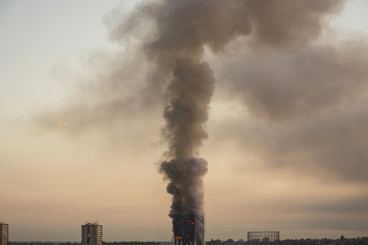 Grenfell Tower at 05.48 local time on the day of the indicent. Image © Selim Halulu