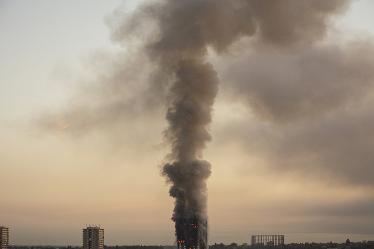 "Indications Suggest That Hundreds of Residential Towers in England Are Clad in Potentially Combustible ""Reynobond PE"", Grenfell Tower at 05.48 local time on the day of the indicent. Image © Selim Halulu"