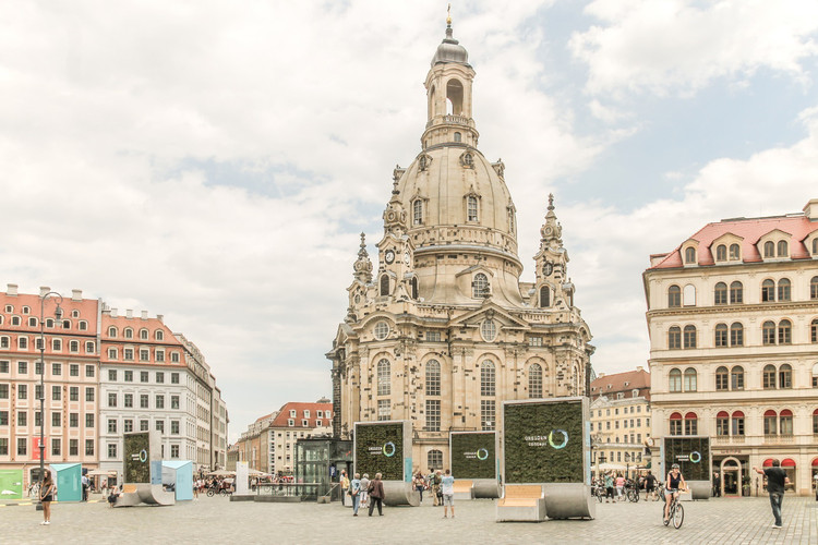 "These ""Artificial Trees"" Can Filter as Much Pollution From the Air as 275 Natural Trees, Eight CityTrees in front of the Frauenkirche in Dresden, Germany. Image © Green City Solutions"