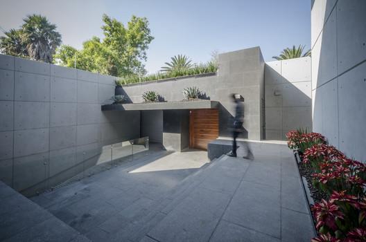 The Palmas House / Revolution
