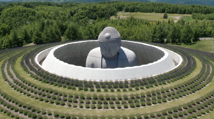 Tadao Ando Envelops Giant Buddha Statue in Lavender-Planted Hill Temple, Screenshot of video courtesy Hokkaido Fan Magazine
