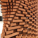 MORE THAN 2,000 UNIQUE ROBOTICALLY MANUFACTURED BRICKS GENERATE VARIABLE WALLS IN THIS PAVILION