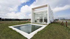 House 202 / Unoencinco Arquitectura