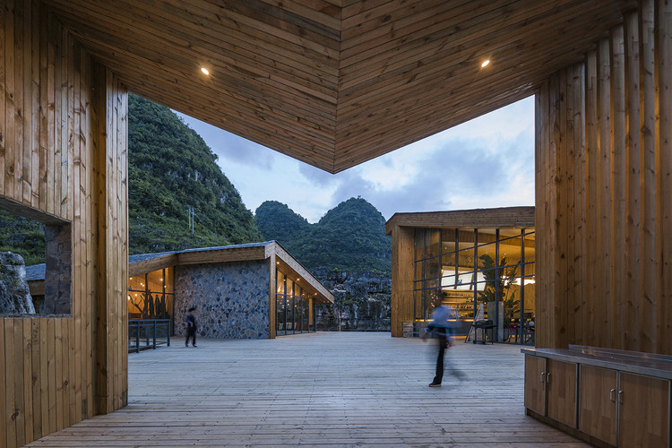 Tourist Center of Anlong Limestone Resort  / 3andwich Design / He Wei Studio, The view of Red Point Restaurant and Tequila Club through Pavilion M.