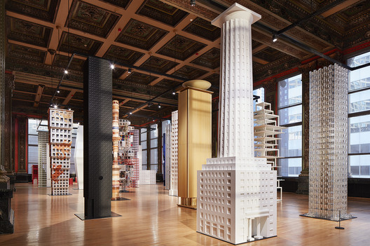A reconstruction of Loos' proposal (center) accompanies new towers by an international group of young architects. Courtesy of Chicago Architecture Biennial. Image © Steve Hall