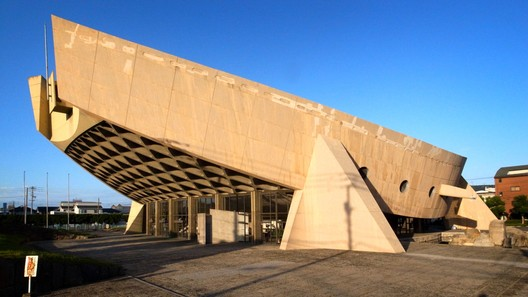 Japan, Kagawa Prefectural Gymnasium. The Kagawa Prefectural Gymnasium, seen from the southwest, was designed to evoke the form of a traditional Japanese wooden barge, 2014. Noriyuki Kawanishi/World Monuments Fund