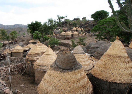 Nigeria, Sukur Cultural Landscape. Traditional Sukur houses are round clay buildings with thatched roofs, 2006. NCMM/Dipo Alafiatayo/ World Monuments Fund