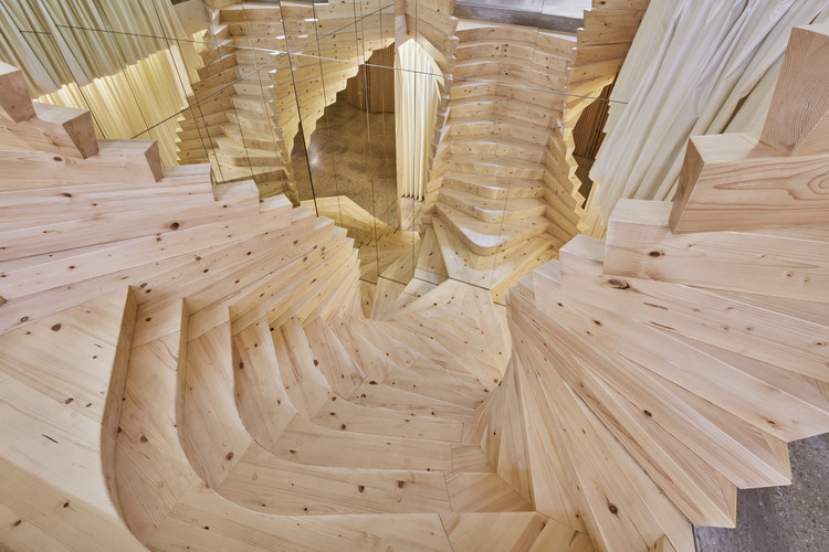 ACME's Wildly Twisting Wooden Staircase Draws Inspiration From Coco Chanel's Famous Mirror Stair, © Ed Reeve