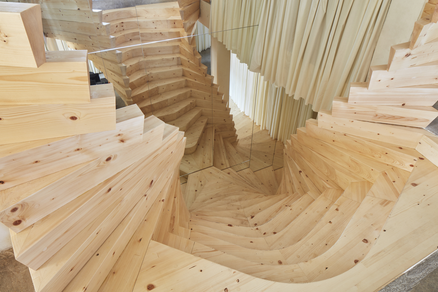 acmes wildly twisting wooden staircase draws inspiration from coco chanels famous mirror stair ed - Wooden Stairs