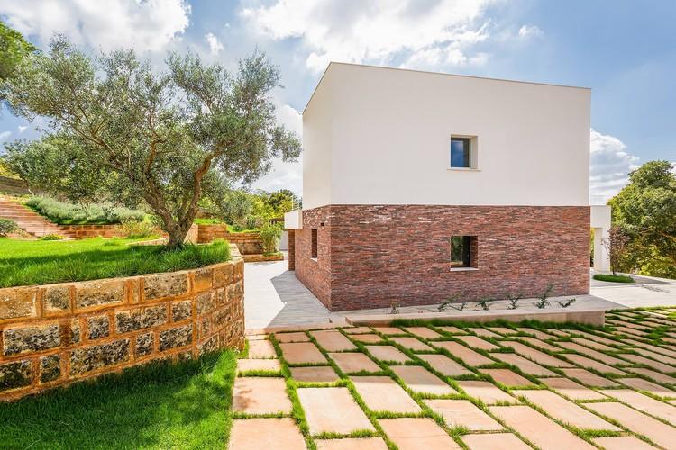 Casa con patio de piedra / Studio 4e, © Angelo Geloso