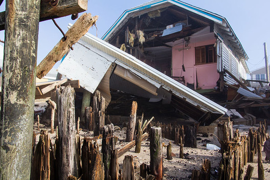 A home destroyed by Hurricane Sandy. New building codes, methods, and materials can potentially prevent catastrophic damage from hurricanes. Image Courtesy of Steve Zumwalt/FEMA