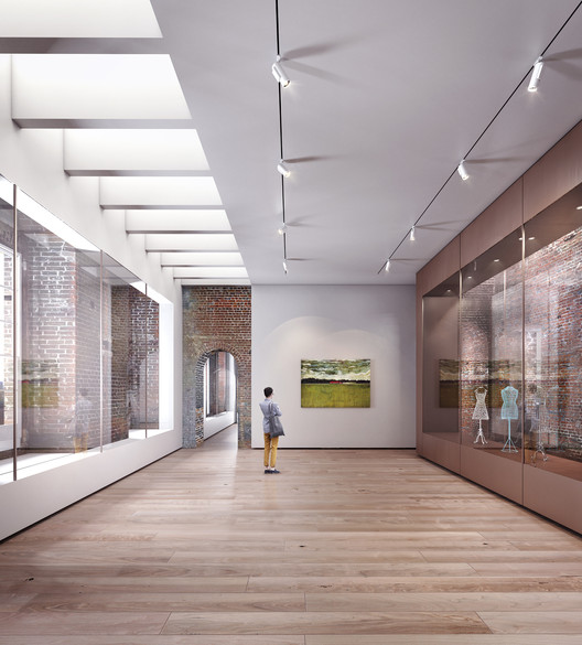 Gallery space with new floors, ceilings and walls slotted into the existing matrix of brick walls. Image © Allies and Morrison