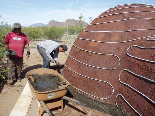 A domed structure under construction made almost entirely of Ferrock. Image © David Stone
