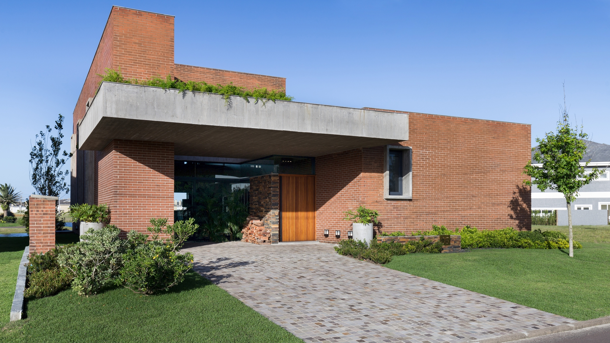 Casa marcon ramella arquitetura archdaily brasil for Maison moderne 64