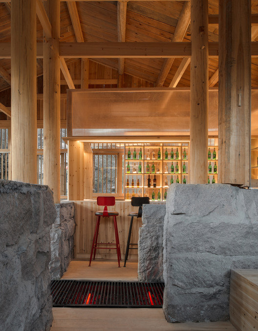 The stone walls of the original pigsty were maintained of 'Pigsty Bistro'. Image © Meng Zhou