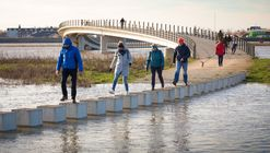 NEXT Architects' Zalige Bridge Transforms Into Stepping Stones During Flood Conditions