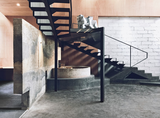 Staircase and pond. Image Courtesy of CAL Architects