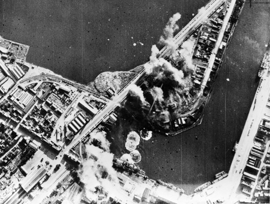 """Image source: British official photo from OWI., <a href=""""https://commons.wikimedia.org/wiki/File:RAF_attack_Saint_Malo_31_Jul_1942.jpg"""">RAF attack Saint Malo 31 Jul 1942</a>, marked as public domain, more details on <a href=""""https://commons.wikimedia.org/wiki/Template:PD-UKGov"""">Wikimedia Commons</a>"""