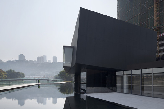 Mountain lake and the building. Image © Zhi Xia